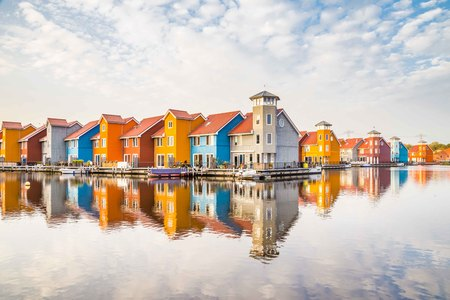 Colorful housese reflected in the water in Groningen in the Netherlands
