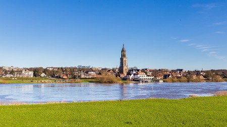 Landscape with a view on the flooded river Rhine and the small town  Rhenen in the Netherlands