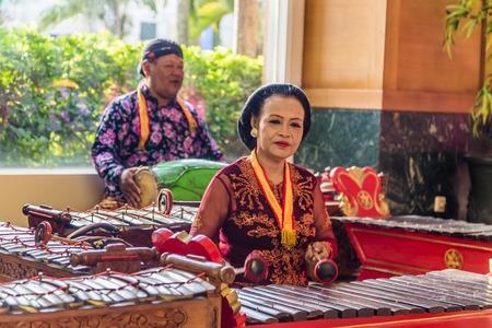 Jakarta, Indonesia - November, 02, 2017 Couple playing music on tradiitonal Indonesian instruments Editorial