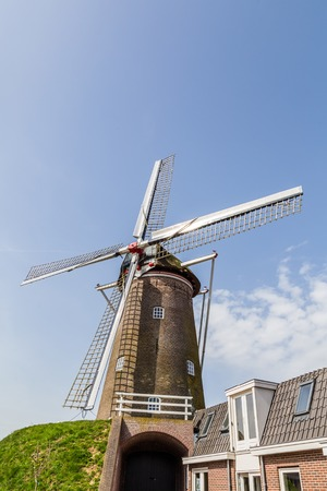Traditional Dutch Windmill  on a platform in the centre of Amerongen in the Netherlands