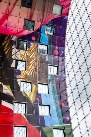 Rotterdam, Netherlands - June, 21 2018: Vibrant colors on the ceiling of the market hal. The  Market Hall, a residential and office building with a fresh market  underneath, located in Rotterdam.
