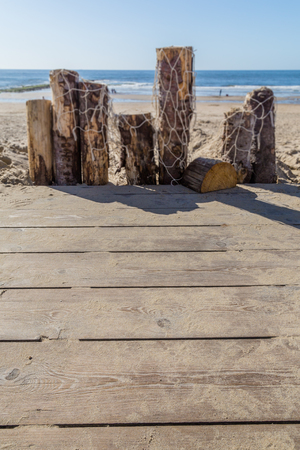 Wooden poles with fishing nets at the sandy beach on the coast n the Netherland Banco de Imagens