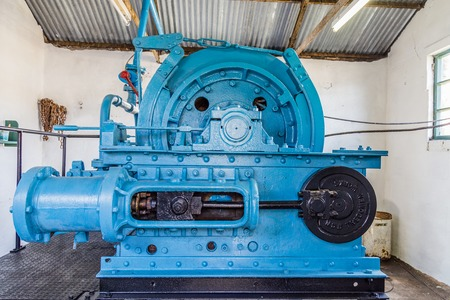 Blaenavon,Wales, UK - July, 25, 2018: Big historical engine activating the Pithead at  heritage site Blaenavon Colliery Big Pit Natiional Museum in Wales, UK Editorial