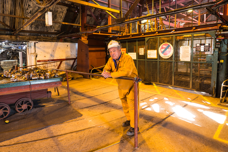 Blaenavon,Wales, UK - July, 25, 2018: Old miner and guide at heritage site Blaenavon Colliery Big Pit Natiional Museum in Wales, UK Editorial