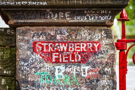 Liverpool, UK -August, 09, 2018: The sign for Strawberry Field in Liverpool . The place became fanmous by song Strawberry Fields Forever from the beatles. Редакционное