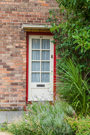 Liverpool, United Kingdom: August 02, 2018: Front door of the childhood home of Sir Paul McCartney on 20 Forthlin Road in Liverpool.