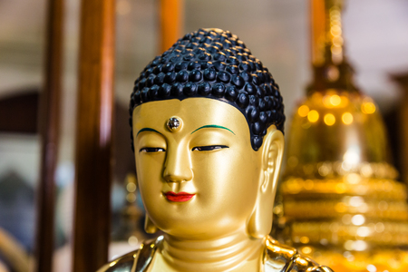 Kandy  Sri Lanka July 29 2017 -Buddha statue as part of the interior of the Temple of the Tooth Relic on he first floor of the temple in Kandy, Sri Lanka