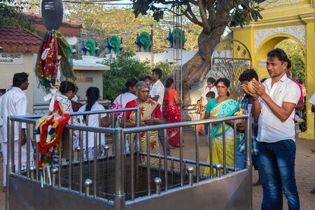 Bandarawela  Sri Lanka August 02 2017 -  Hindu ritual breaking coconuts in Ruhunu Maha Kataragama Devalaya temple complex in  Sri Lanka.