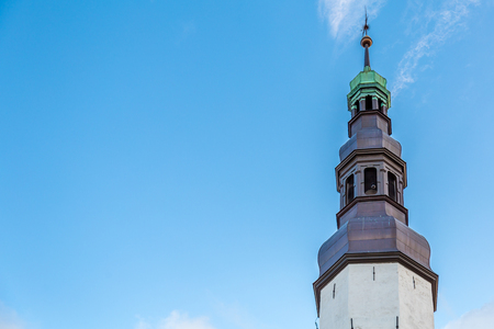 Top of the St Nicolas  Church in the old town of Tallinn in Estonia Stockfoto - 115482299