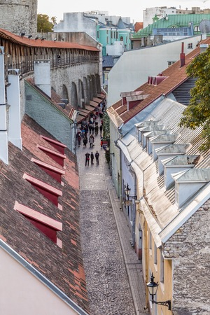 Tallinn, Estonia - September 29, 2018: Cityscape with the town wall of Talinn with a view on the cobbled street along the wall  in the old town of Tallinn in Estonia