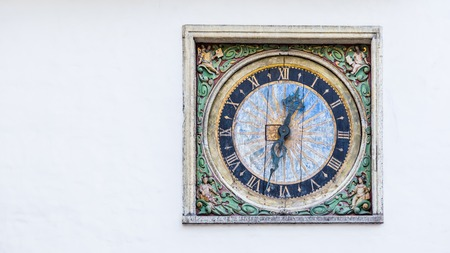 Ancient clock at the Church of the Holy Spirit in the historic center of Tallinn, Estonia Redactioneel