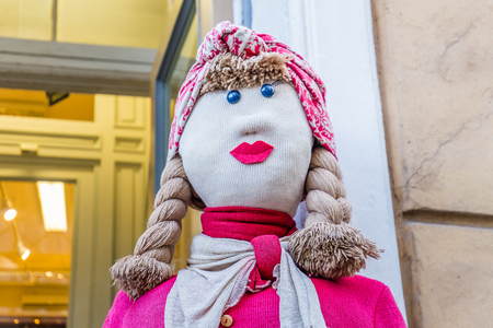 Tallinn, Estonia - September 29, 2018: Knitted puppet at the entrance of a souvernir shop in the old town of Tallinn in Estonia