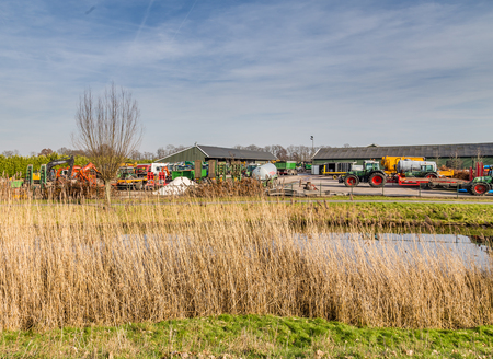 Agriculture equipment and machinery parked at a agriculture transport company in the Netherlands Stockfoto