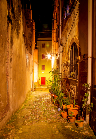 Narrow ancient streets during the evening in the little medieval town Bosa, Sardinia Island, Italy Stockfoto