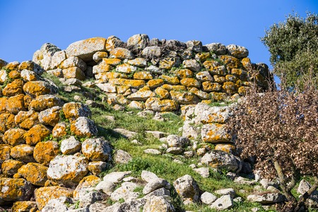 Remains of nuraghe or fortress from the bronze age at Archeological site of Tamuli, Sardinia island, Italy 写真素材