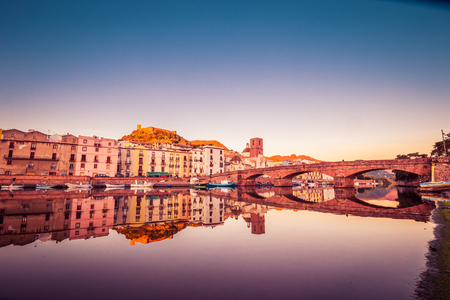 Cityscape during sunset of the colorful small town Bosa in Sardinia, Italy
