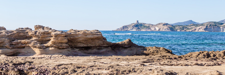 Panorama with tower Argentina at the West coast along Costa Tentizzos near Bosa on Sardinia islands, Italy