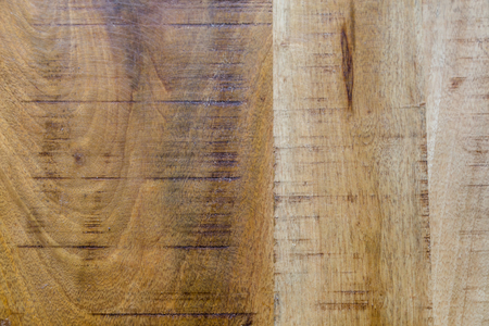 Wood texture background of mango wood. Furnitrue of old mango trees is very sustainable.