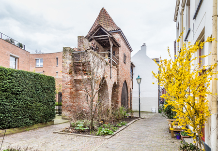 Ancient city wall  with a small house in Zutphen, a medieval city along the river IJssel in Gelderland in the Netherlands