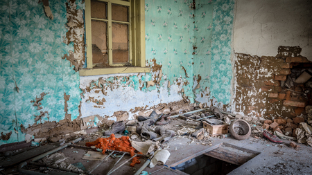 Old shoes in an abandoned little house in Belarus Chernobyl exclusion zone, recently opened for the public from april 2019. Stockfoto