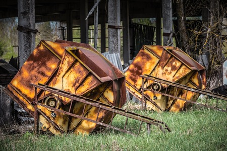 Rusted feed silos in an abandoned farm in Belarus Chernobyl exclusion zone,