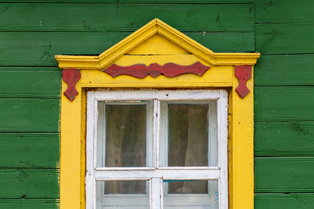 Facade and window of a colorful little Belarus wooden house