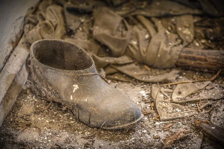 Old dirty boot in an abandoned old farm in Belarus, Chernobyl exclusion zone