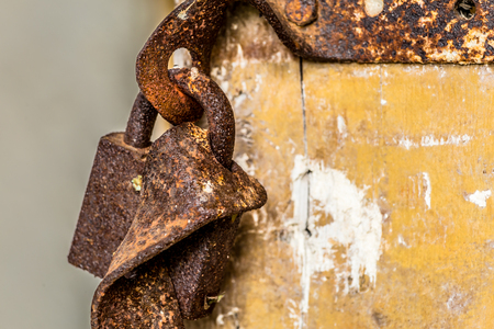 Rusted lock hanging on a door in an abandoned old farm in Belarus, Chernobyl exclusion zone