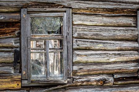 Broken window of an abandoned house in Belarus