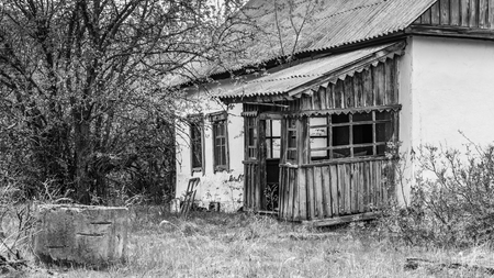 Abandoned broken house in Black and White in the exclusion zone of Chernobyl in Belarus