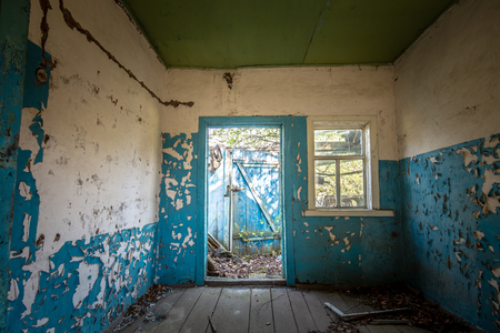 Blue interior of the kitchen of an abandoned house in Chernobyl exclusion zone in Belarus