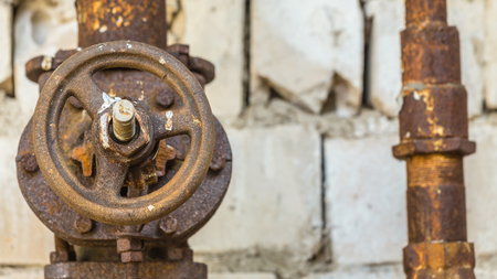 Old and rusty industrial pipe valve at power plant
