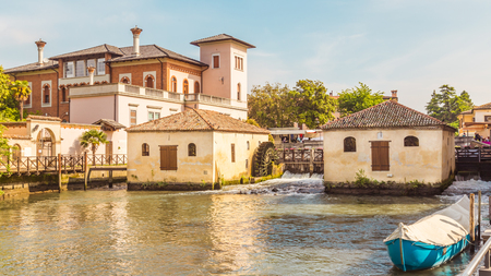 Cityscape of Portogruaro in Veneto Italy with lemene river, tower and mills