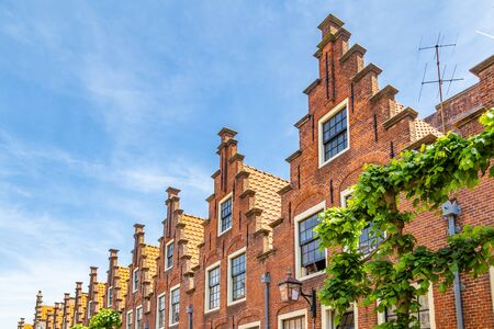 Row of traditional Duch stepped gable houses in Haarlem in the Netherlands