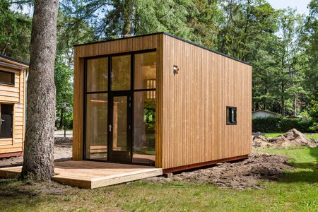 Beekbergen, Netherlands, June 21 2019: Wooden tiny house under construction. A new form of living philosophy to reduce ecological footprint