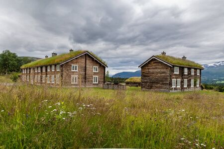 Traditional wooden houses with roof covered with grass, plants and flowers in Oppdal in Norway, Scandinavia