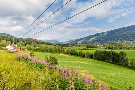 Panorama of Sorr-Fron municipality in Gudbrandsdal with mountains, village and farmland in Oppland county, Norway Stockfoto
