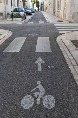 Bicycle trail sign for cyclist in the streets of center of Orleans following the touring circuit along the Loire in France.