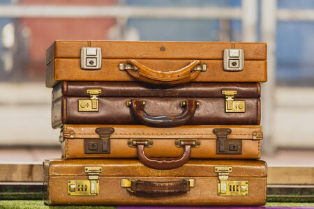 Pile of vintage brown leather suitcases