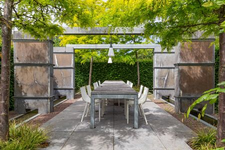 Open garden design with stone walles and pergola, rooftop, and terrace