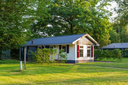 Landscape with colorful wooden vacation home at recreation park in the middel of nature in the Netherlands
