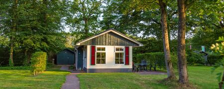 Web banner with colorful vacation home at recreation park in the middle of nature in the Netherlands