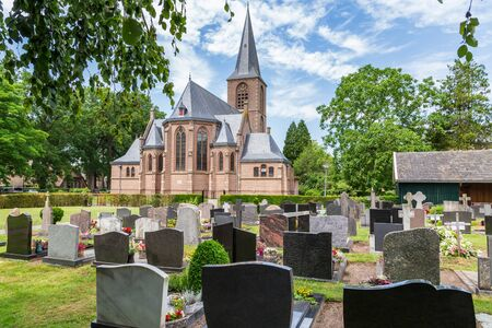 Protestant gothic church and cemetry of the little Dutch village Rechteren in Overijssel, Netherlands, Europe