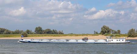 Inland motor tanker sailing he river Waal near Nijmegen in the Netherlands