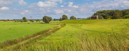 Dutch polder panorama with dyke and bridge near Nijmegen, Gelderland in the Netherlands