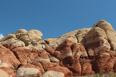 clear blue sky view in old Nevada Las Vegas desert to a big red rock