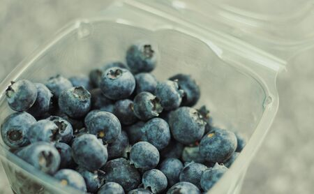 Some blueberries in a plastic container