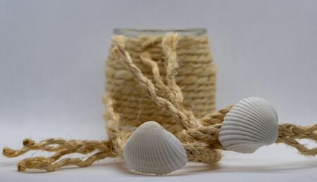 Photo of beach shell decoration with rope and glass boat