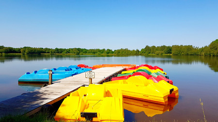 Colorful pedal boats on the boat dock