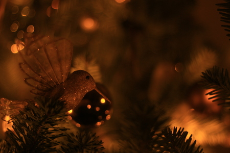 Close-up photo of golden christmas tree decorations